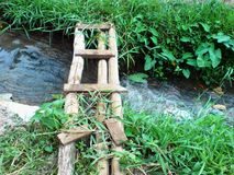 Bamboo bridge on a trench Stock Images