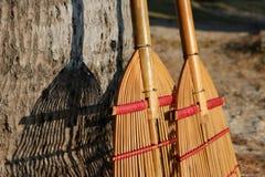 Bamboo broom on the beach. Stock Photos