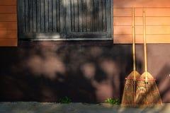 Bamboo broom on the walls Stock Photos