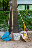 Bamboo brooms and metal dustpan leaning Royalty Free Stock Image