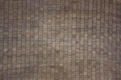 Bamboo brown straw mat as abstract texture background composition, top view above stock image