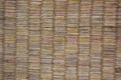 Bamboo brown straw mat as abstract texture background composition, top view above royalty free stock photo