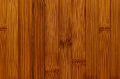 Bamboo brown wood texture, vertical plank, top view, closeup. Stock Photo