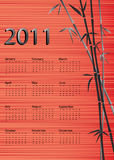 Bamboo calendar red silk background Stock Images