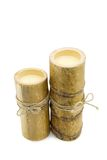Bamboo candles. Two bamboo candles over white background Royalty Free Stock Photos