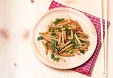 Bamboo Caterpillar fried on wooddish Royalty Free Stock Images