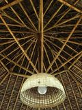 Bamboo Ceiling. A ceiling made of bamboo beam with hanging light fixture Royalty Free Stock Photos