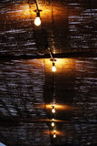 Bamboo ceiling. View of a wet bamboo ceiling with lightbulbs lit on the center Stock Photos