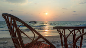 Bamboo chair and table at seaview sunset Royalty Free Stock Photos