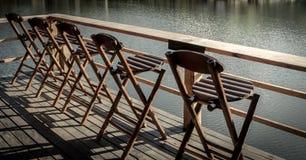 Bamboo chairs on a beautiful lake Royalty Free Stock Image