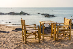 Bamboo chairs and table with clear sky on Pak Weep beach in the evening Royalty Free Stock Images