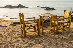 Bamboo chairs and table on Pak Weep beach in the evening Royalty Free Stock Photo