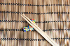 Bamboo chopsticks on a handmade origami chopstick holder Stock Photos