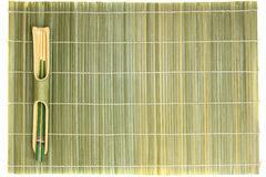 Bamboo chopsticks and mat Royalty Free Stock Image