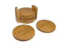 Bamboo coasters. Set of six bamboo coasters isolaten on a white background Royalty Free Stock Image