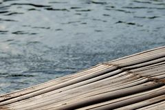 Bamboo flooring at the riverside. Bamboo, a common material of a raft flooring at the waterfront in Asia and tropical countries Royalty Free Stock Images