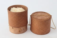 Bamboo container for holding cooked glutinous rice. Stock Image