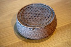 Hand woven bamboo container royalty free stock photo