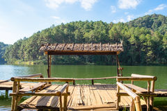 Bamboo cottage floating on rim reservoir Royalty Free Stock Photos