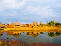 Bamboo cottages and and thier reflections in pond in Nakorn Ratc Stock Image