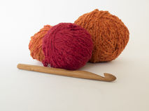 Bamboo crochet hook and bright balls of wool on white background Stock Photo