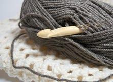 Bamboo Crochet hook in brown yarn Royalty Free Stock Image