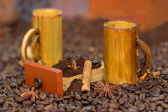 Bamboo cups and coffee beans, cofee grinded in wood box, anis and cinnamon. On table with coffeу beans royalty free stock image