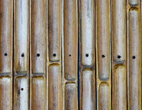 Bamboo cut wall with nail background Royalty Free Stock Images