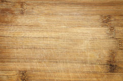 Bamboo cutting board. Used scratched bamboo wood cutting board background detail Royalty Free Stock Photography