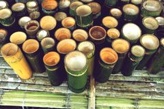 Bamboo cylinder, green bamboo cup. Prepare use for herbal drinks in local market Royalty Free Stock Images