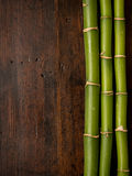 Bamboo on wood background Royalty Free Stock Photos
