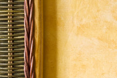 Bamboo detail and yellow wall Stock Photography