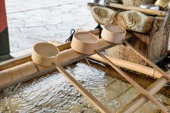 Bamboo dipper put sorted on basin traditional japanese in temple. Bamboo wood dipper put sorted on basin traditional japanese in temple Royalty Free Stock Photos