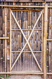 Bamboo door on fence Royalty Free Stock Photo
