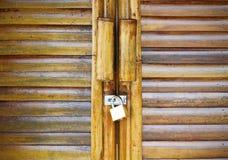 Bamboo door and lock key Royalty Free Stock Photography