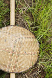 Bamboo farmer hat on grass. Royalty Free Stock Image