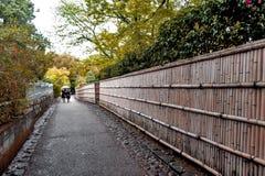 Bamboo fence along walkway in Arashiyama, Kyoto, Japan Stock Photo