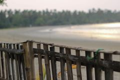 Bamboo fence on the beach stock images