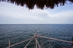 Bamboo fence on the cliff at Koh Sichang,Chonburi,Thailand. Royalty Free Stock Photography