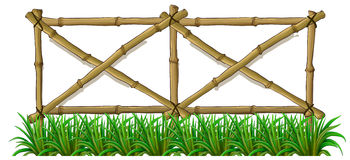 A bamboo fence with grass Royalty Free Stock Photos