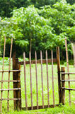 Bamboo fence. On  the  grasses  field Stock Photos