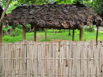 Bamboo fence and leaves roof Stock Photos