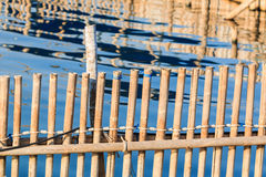 Bamboo fence near the sea Royalty Free Stock Image