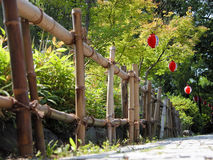 Bamboo fence and papers lanterns Royalty Free Stock Photography