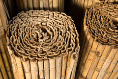Bamboo fence in rolls. Light brown fence of bamboo. Rolls royalty free stock images
