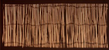 Bamboo fence shadow on the wall Stock Photography