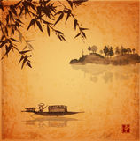 Bamboo, fishing boat and island with trees Stock Photography
