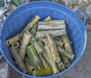 Bamboo flask in the basket. Bamboo flask in the blue basket Royalty Free Stock Photo