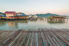 Bamboo floor with Fishing Village to the sea Royalty Free Stock Images
