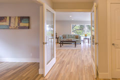 Bamboo floor and wide open double doors in San Diego home Royalty Free Stock Photography